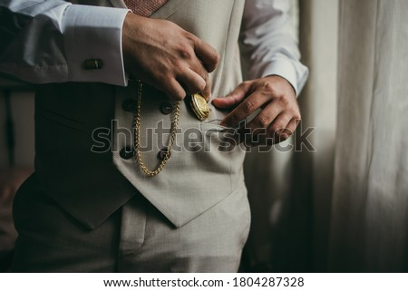 Elegant man with suit. Closeup groom hands holding a pocket watch. Foto d'archivio ©