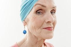 Elegant mature lady wearing stylish turban