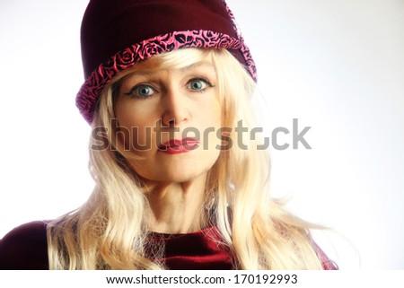 Elegant mature woman in hat fashion portrait. Retro style senior woman portrait 60 years old