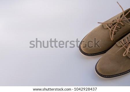 Elegant men's shoes over white background #1042928437