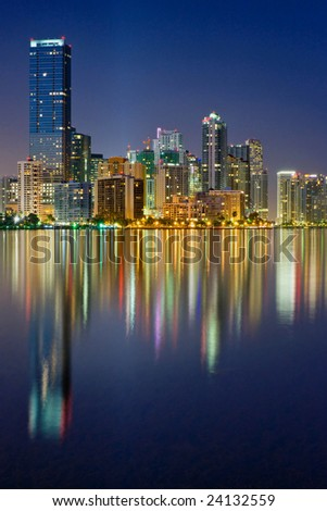 elegant miami florida skyline reflecting in biscayne bay at dusk