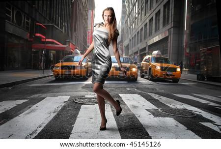 elegant model crossing a NY city street