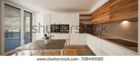 Elegant modern kitchen with view. Nobody inside #708440080