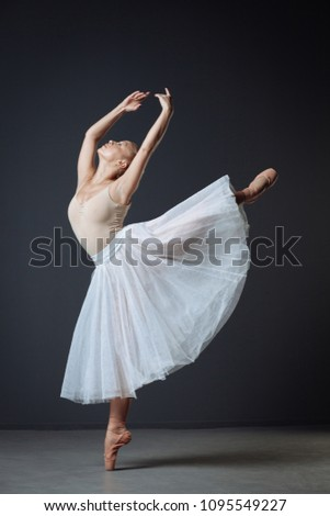 Elegant movements. Pretty persistent patient dancer dancing in the empty room on the right leg lifting her left leg and improving her mowement. #1095549227