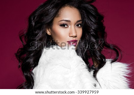 Elegant mulatto girl with fur #339927959