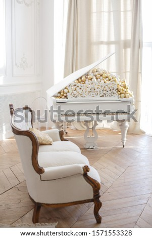 Elegant old white piano with broken keys Classic interior.