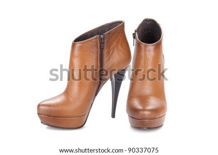 Elegant pair of woman's shoes isolated on a white background
