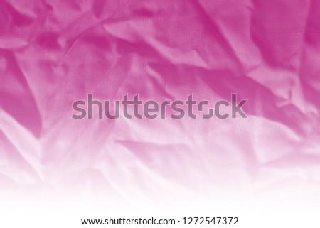 Elegant pink textile background. Silk cloth texture. Fabric pattern.