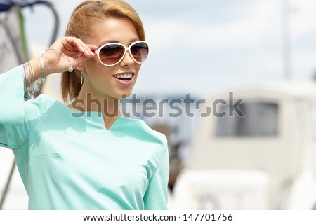 Elegant retro woman wear dress ,  near the yacht marine. 60's inspiration  #147701756