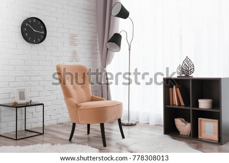 Elegant room interior with comfortable armchair