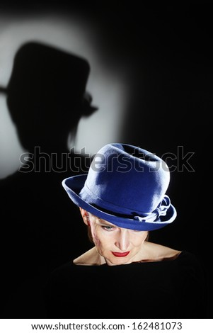 elegant senior woman in hat...