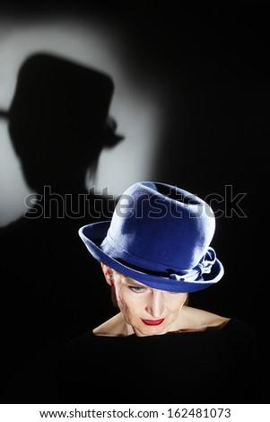 elegant senior woman in hat...