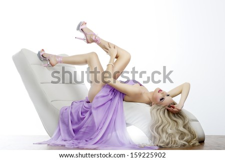 Elegant sensual young woman in dress