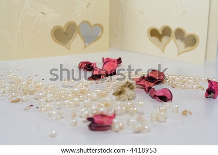Elegant Setup With Wedding Invitations, Pearl Necklaces ...