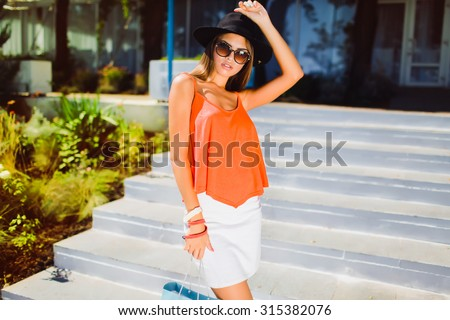Elegant sexy young business woman brunette hair evening makeup wearing dress suit top skirt high heels shoes business clothes for meetings walks summer fall collection perfect body shape glasses
