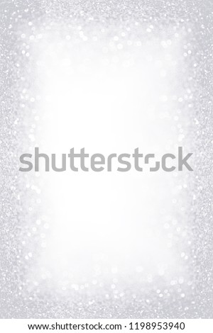 Elegant silver white glitter sparkle confetti background for gray happy birthday party invite, Christmas ice frost border, frosty winter icy snow, diamond jewelry bling or 25 wedding anniversary frame #1198953940