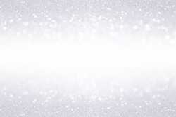 Elegant silver white glitter sparkle confetti background for happy birthday party invite, Christmas banner, icy snow fall border, frosty winter, 25th anniversary bling or shiny wedding glitz backdrop
