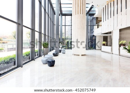 elegant stools and table in huge and bright hall