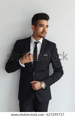 Elegant stylish young handsome man in a suit. Studio fashion portrait.  #627299717