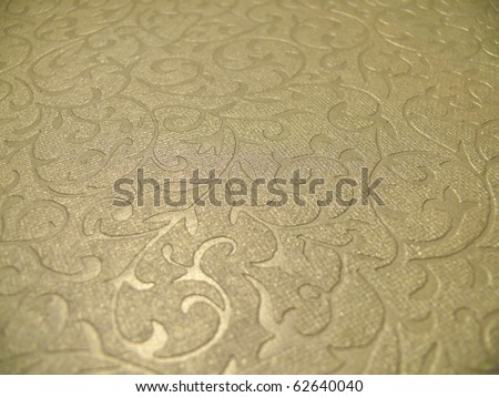 Elegant subtle decorative golden christmas paper surface close up. More of this motif & more backgrounds, ornaments in my port.