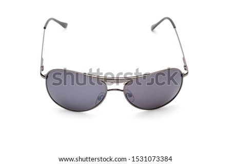 Elegant sunglasses in dark purple colored glasses on an isolated white background #1531073384