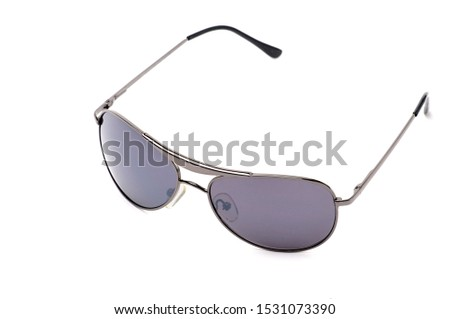 Elegant sunglasses in dark purple colored glasses on an isolated white background #1531073390