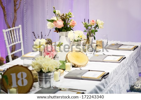 Elegant table set in green and white for wedding or event party