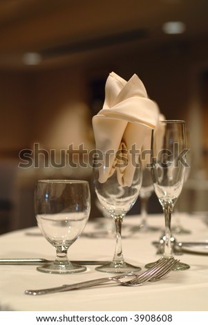 stock photo Elegant table setting at a wedding focus on the napkin in the