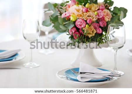 Elegant table setting with beautiful flowers, closeup #566481871