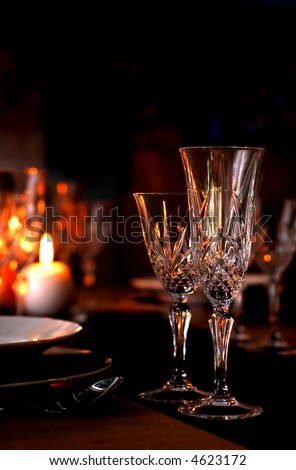 stock photo Elegant table setting with champagne glasses and candles