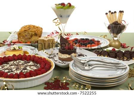 Elegant table with many desserts and fruits (pecan swirl cake, raspberry pie, rice pudding, cheese cake and more)
