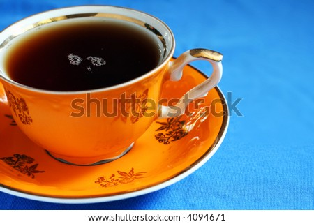 Elegant tea cup with freshly made tea.