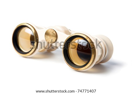Elegant vintage small theater binocular, decorated with ivory imitation and golden details, isolated on white background