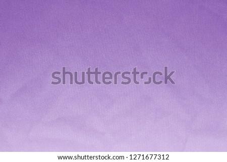 Elegant violet textile background. Silk cloth texture. Fabric pattern.