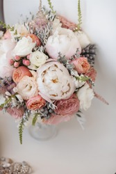 Elegant wedding flower bouqet on texture background with bridal shoes tiffany colour