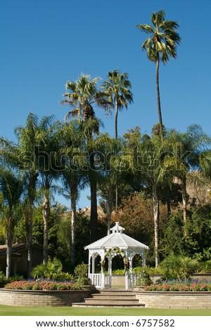 Elegant Wedding Gazebo with Steps and Palm Trees.
