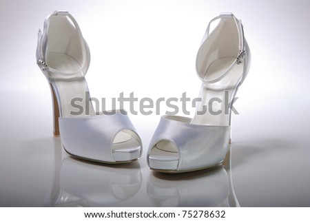 Elegant wedding shoes over gradient gray background