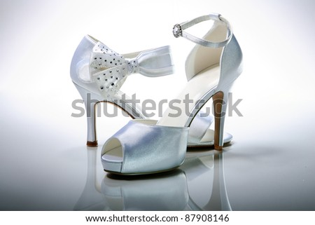 stock photo Elegant wedding shoes over gradient gray background