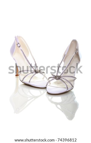 stock photo Elegant wedding shoes over white background