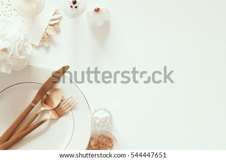 Elegant white and gold bridal dinner concept styled with wedding accessories.