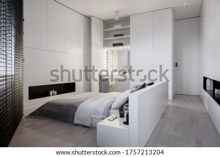 Elegant, white bedroom with big bed and stylish dressing table with light bulbs around mirror