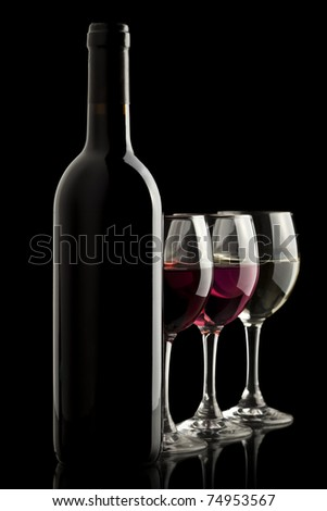 Elegant wine bottle with red, white and rose wine glasses in a black background