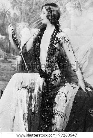 Elegant woman admiring her form