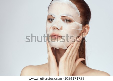 elegant woman in a thin face mask