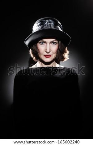Elegant woman in hat fashion portrait. Beautiful mature senior woman style 60 years old