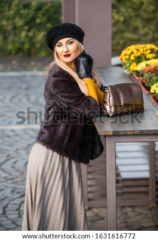 elegant woman wear fur coat. stylish parisian lady in beret. Versatile Textures. fashion and beauty. successful businesswoman in street. autumn female outfit. apparel for european winter.