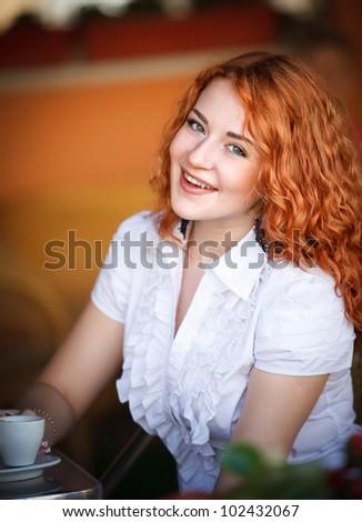 Elegant woman  with a coffee mug in cafe