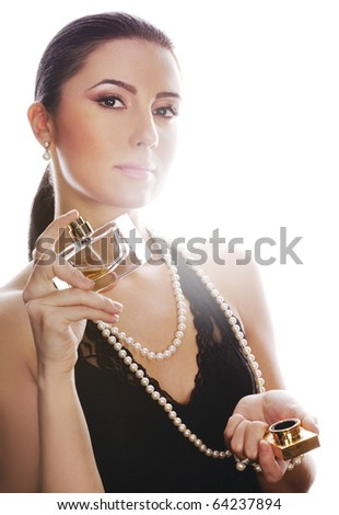 Elegant woman with perfume on white