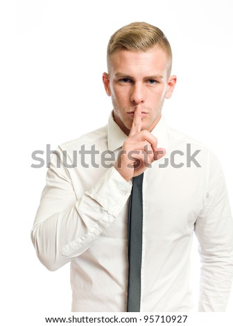 Elegant young businessman showing silence gesture, hand over mouth