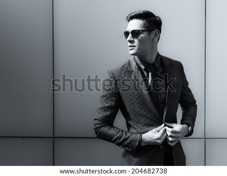 Elegant young handsome man. Fashion portrait.
